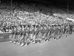 FILE - In this July 29, 1948 file photo, French women athletes march past the Royal Box in Wembley Stadium, London, during the opening ceremony of the XIV Olympiad. London was still cleaning up bombing damage from World War II when it staged the Olympics in 1948. Britain was also struggling financially; food, clothing and gas were still being rationed. The athletes had to bring their own towels and, with housing in short supply, were accommodated in schools and Royal Air Force camps. The games were organized in less than two years, and despite the tiny budget it was a success, its legacies including greater sporting opportunities for women. (AP Photo, File)