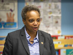 Chicago Mayor Lori Lightfoot visits a third grade class at Roswell B. Mason Elementary School on Friday Nov. 1, 2019, in Chiago. Chicago teachers and the nation's third-largest school district reached a labor contract deal on Thursday, ending a strike that canceled 11 days of classes for more than 300,000 students. (Ashlee Rezin Garcia/Chicago Sun-Times via AP)