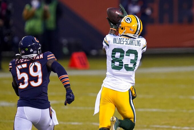 Green Bay Packers' Marquez Valdes-Scantling catches a touchdown pass in front of Chicago Bears' Danny Trevathan during the first half of an NFL football game Sunday, Jan. 3, 2021, in Chicago. (AP Photo/Charles Rex Arbogast)