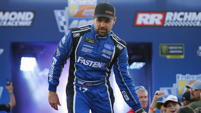 Ricky Stenhouse Jr., greets fans during driver introductions for the NASCAR Monster Energy Cup series auto race at Richmond Raceway in Richmond, Va., Saturday, Sept. 21, 2019. (AP Photo/Steve Helber)