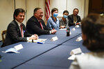 Secretary of State Mike Pompeo, second from left, meets with Chinese dissidents at the Richard Nixon Presidential Library, Thursday, July 23, 2020, in Yorba Linda, Calif. (AP Photo/Ashley Landis, Pool)