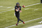 Cincinnati quarterback Desmond Ridder throws a pass against Army during the second half of an NCAA college football game Saturday, Sept. 26, 2020, in Cincinnati, Ohio. Cincinnati beat Army 24-10. (AP Photo/Jay LaPrete)