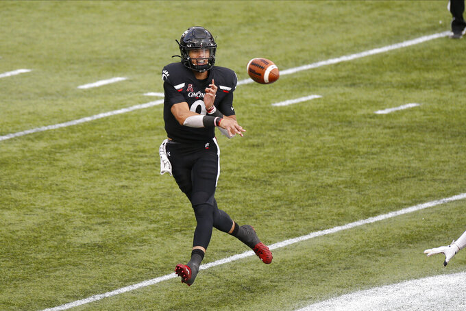 Cincinnati quarterback Desmond Ridder throws a pass against Army during the second half of an NCAA college football game Saturday, Sept. 26, 2020, in Cincinnati, Ohio. Cincinnati beat Army 24-10. (AP Photo/Jay LaPrete)