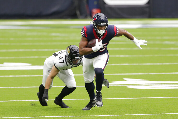 Houston Texans tight end Pharaoh Brown (85) makes a catch in front of Jacksonville Jaguars middle linebacker Joe Schobert (47) during the first half of an NFL football game Sunday, Oct. 11, 2020, in Houston. (AP Photo/Michael Wyke)