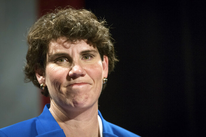 FILE - In this Nov. 6, 2018, file photo, Amy McGrath speaks to supporters in Richmond, Ky.  Democrat Amy McGrath's Senate campaign missed a deadline, Friday, Sept. 6, 2019 set by an attorney seeking a reply to demands from two retired Kentucky coal miners that their images be removed from a campaign ad attacking Senate Majority Leader Mitch McConnell. McGrath's campaign claims both men signed a form giving their permission to appear in the ad. (AP Photo/Bryan Woolston, File)