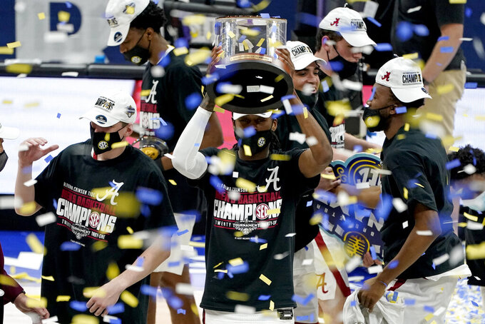 Alabama players celebrate after beating LSU in the championship game of the NCAA college basketball Southeastern Conference Tournament Sunday, March 14, 2021, in Nashville, Tenn. Alabama won 80-79. (AP Photo/Mark Humphrey)