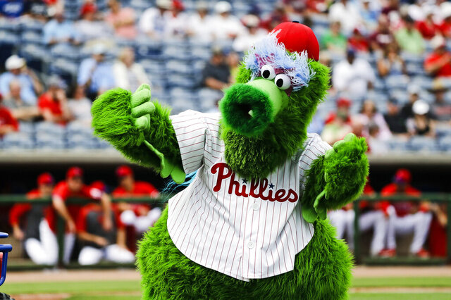 FILE - In this Feb. 25, 2020, file photo, The Phillie Phanatic mascot performs before a spring training baseball game against the Toronto Blue Jays in Clearwater, Fla. Mascots have no other place in baseball should the sport resume. Mascots will be banned. Take a look across the globe and mascots remained a staple of baseball games in Taiwan and the KBO League in South Korea. (AP Photo/Frank Franklin II, File)
