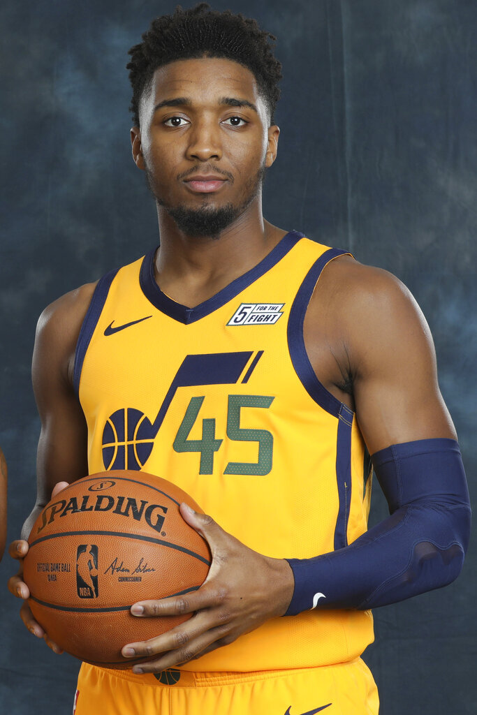 Utah Jazz guard Donovan Mitchell (45) poses for a photograph during the NBA basketball team's media day Monday, Sept. 30, 2019, in Salt Lake City. Mitchell averaged 23.8 points and 4.2 assists in his second season, but struggled at times with his scoring efficiency. (AP Photo/Rick Bowmer)