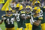 Green Bay Packers' De'Vondre Campbell celebrates his interception during the second half of an NFL football game against the Detroit Lions Monday, Sept. 20, 2021, in Green Bay, Wis. (AP Photo/Mike Roemer)
