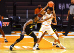 Tennessee guard/forward Yves Pons (35) protects the ball during an NCAA college basketball game against Appalachian State in Knoxville, Tenn., on Tuesday, Dec. 15, 2020.  (Brianna Paciorka/Knoxville News Sentinel via AP)