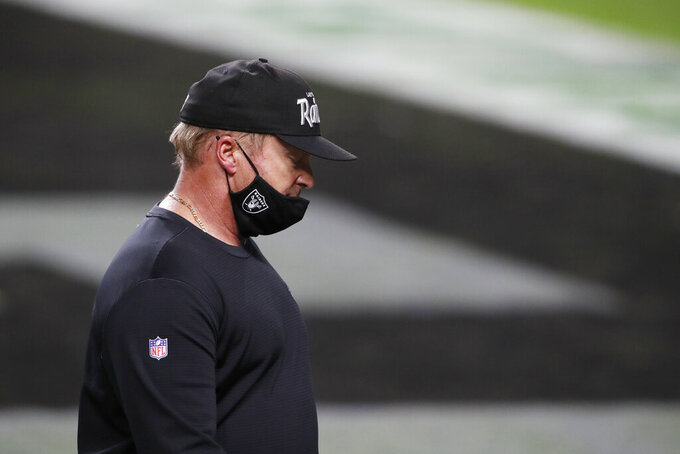 Las Vegas Raiders head coach Jon Gruden walks off the field after losing to the Miami Dolphins in an NFL football game, Saturday, Dec. 26, 2020, in Las Vegas. (AP Photo/Steve Marcus)