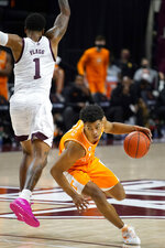 Tennessee guard Jaden Springer (11) drives past Texas A&M guard Savion Flagg (1) during the second half of an NCAA college basketball game Saturday, Jan. 9, 2021, in College Station, Texas. (AP Photo/Sam Craft)