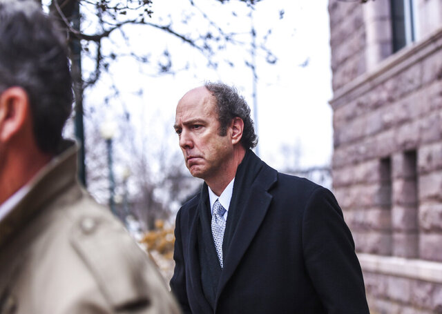 Paul Erickson leaves the federal courthouse on Tuesday, Nov. 26, 2019, in Sioux Falls, S.D. Erickson pleaded guilty to one charge of wire fraud and one charge of money laundering in a fraud scheme that authorities said bilked at least $2.3 million from 78 people.  (Abigail Dollins/The Argus Leader via AP)