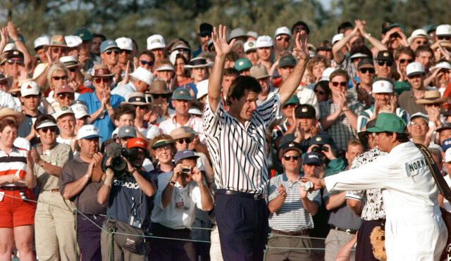 FILE - In this  Sunday, April 14, 1996 file photo, Masters champion Nick Faldo acknowledges the gallery at Augusta National Golf Club in Augusta, Ga. Faldo came from behind to beat Greg Norman by five strokes to win his third Masters. It was voted the 5th-best Masters by a panel of writers (AP Photo/David J. Phillip, File)