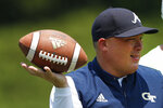 Georgia Tech head coach Geoff Collins works with his kick returners during the team's first preseason NCAA college football practice Wednesday, July 31, 2019, in Atlanta. (AP Photo/John Bazemore)