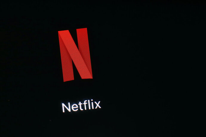 FILE - This March 19, 2018, file photo shows the Netflix app on an iPad in Baltimore. Netflix reports earnings Wednesday, July 17, 2019. (AP Photo/Patrick Semansky, File)