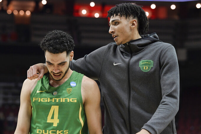 Oregon's Ehab Amin (4) leaves the court with Miles Norris following a men's NCAA Tournament college basketball South Regional semifinal game against Virginia, Friday, March 29, 2019, in Louisville, Ky. Virginia won 53-49. (AP Photo/Timothy D. Easley)
