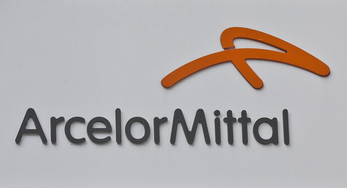 The Logo of the steel company ArcelorMittal is pictured in Saint Denis, outside Paris, France, Wednesday, Sept. 13, 2017. Cleveland-Cliffs is making its second billion-dollar acquisition in less than a year with the purchase of steel maker ArcelorMittal's U.S. business for about $1.4 billion in cash and stock. About a third of the deal will be an up front cash payment of about $505 million, the companies said Monday, Sept. 28, 2020. ArcelorMittal will also receive stock in Cleveland-Cliffs valued at about $873 million. (AP Photo/Michel Euler)