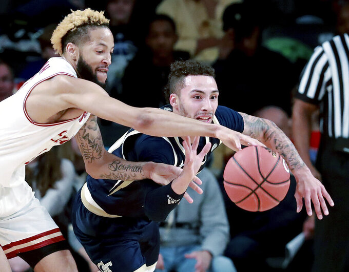 Georgia Tech guard Jose Alvarado steals the ball from Boston College guard Ky Bowman in an NCAA college basketball game on Sunday, March 3, 2019, in Atlanta. (Curtis Compton/Atlanta Journal-Constitution via AP)