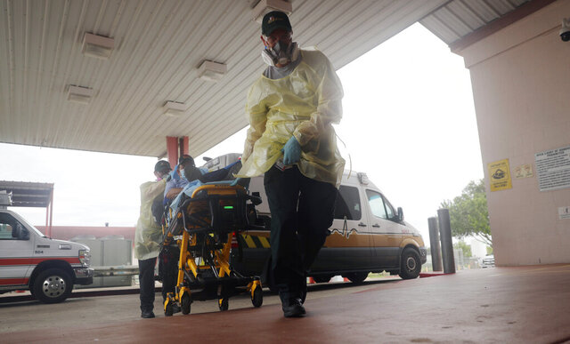 A man arrives at Starr County Memorial Hospital, Tuesday, July 28, 2020, in Rio Grande City, Texas. On America's southern doorstep, the U.S. failure to contain the pandemic has been laid bare. (AP Photo/Eric Gay)