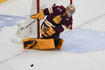Minnesota Duluth goaltender Zach Stejskal stops a shot by Massachusetts during the third period of an NCAA men's Frozen Four hockey semifinal in Pittsburgh, Thursday, April 8, 2021. (AP Photo/Keith Srakocic)
