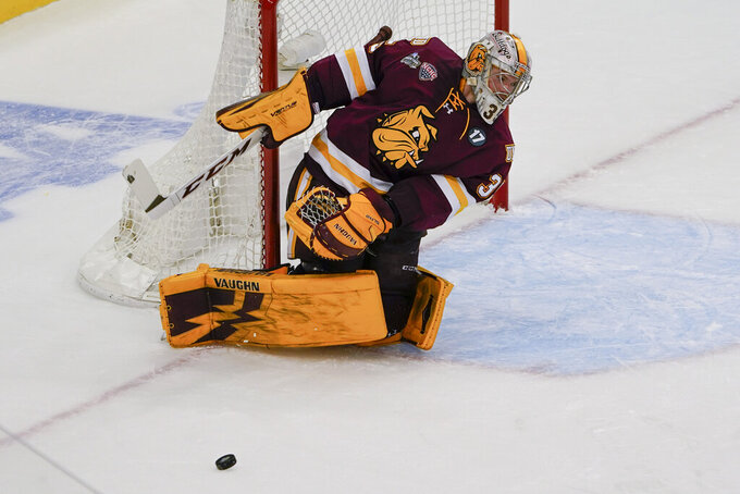 Minnesota Duluth goaltender Zach Stejskal stops a shot by Massachusetts during the third period of an NCAA men's Frozen Four hockey semifinal in Pittsburgh, Thursday, April 8, 2021. (AP Photo/Keith Srakocic)