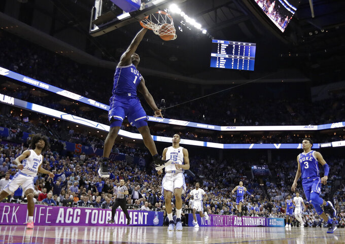 Duke's Zion Williamson (1) dunks against North Carolina during the second half of an NCAA college basketball game in the Atlantic Coast Conference tournament in Charlotte, N.C., Friday, March 15, 2019. (AP Photo/Chuck Burton)