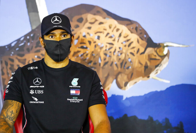 First placed Mercedes driver Lewis Hamilton of Britain sits during a press conference after the the Styrian Formula One Grand Prix at the Red Bull Ring racetrack in Spielberg, Austria, Sunday, July 12, 2020. (Antonin Vincent/Pool via AP)