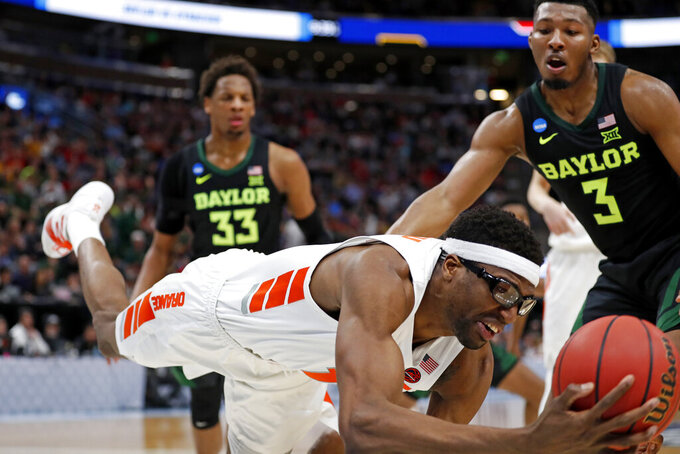 Syracuse center Paschal Chukwu, left, dives for the ball in front of Baylor guard King McClure (3) during the second half of a first-round game in the NCAA men's college basketball tournament Thursday, March 21, 2019, in Salt Lake City. (AP Photo/Jeff Swinger)