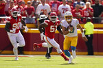 Los Angeles Chargers quarterback Justin Herbert (10) runs during the first half of an NFL football game against the Kansas City Chiefs, Sunday, Sept. 26, 2021, in Kansas City, Mo. (AP Photo/Charlie Riedel)