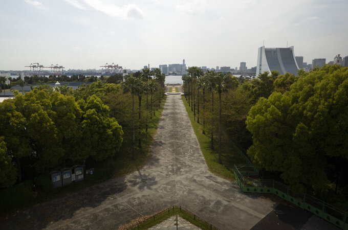 This photo shows part of the Shiokaze Park, planned to be used for the postponed Tokyo 2020 Olympic Games, in Tokyo Thursday, April 8, 2021. Many preparations are still up in the air as organizers try to figure out how to hold the postponed games in the middle of a pandemic. (AP Photo/Hiro Komae)