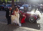 A bride arrives for her wedding at a church in front of Plaza Nunoa in Santiago, Chile, Saturday, Oct. 26, 2019. At least 19 people have died in the turmoil that has swept the South American nation. The unrest began as a protest over a 4-cent increase in subway fares and soon morphed into a larger movement over growing inequality in one of Latin America's wealthiest countries. (AP Photo/Esteban Felix)