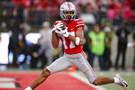 Ohio State receiver Chris Olave catches a touchdown pass against Wisconsin during the first half of an NCAA college football game Saturday, Oct. 26, 2019, in Columbus, Ohio. (AP Photo/Jay LaPrete)