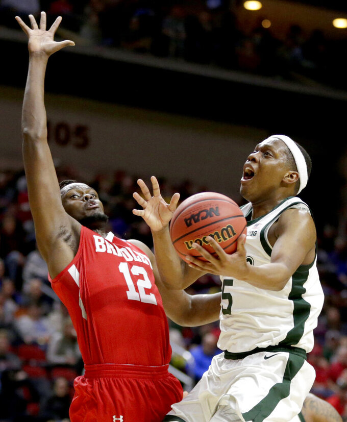 Michigan State's Cassius Winston (5) goes to the basket against Bradley's Koch Bar (12) during the second half of a first round men's college basketball game in the NCAA Tournament in Des Moines, Iowa, Thursday, March 21, 2019. (AP Photo/Nati Harnik)