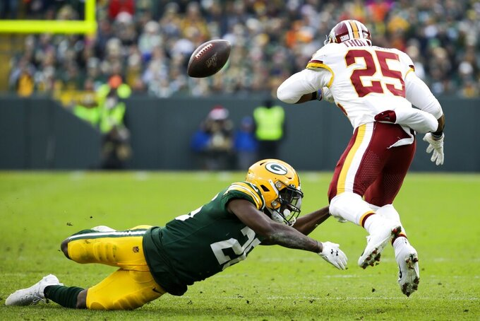 Washington Redskins' Chris Thompson fumbles as he is hit by Green Bay Packers' Darnell Savage during the second half of an NFL football game Sunday, Dec. 8, 2019, in Green Bay, Wis. The Redskins recovered the fumble. (AP Photo/Mike Roemer)
