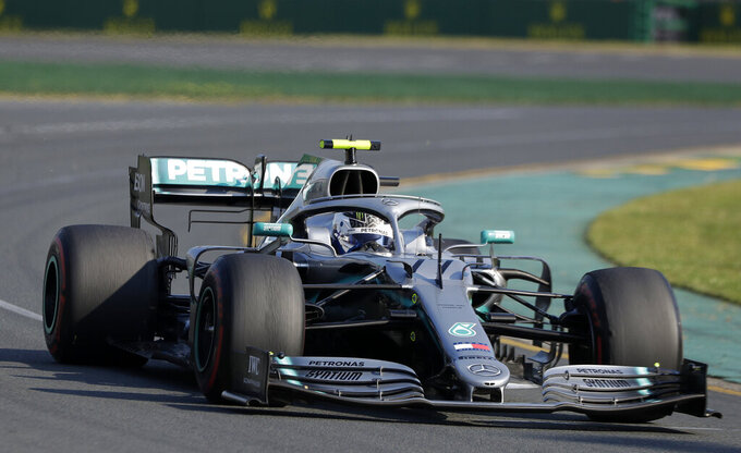 Bottas beats Mercedes teammate Hamilton to win Australian GP