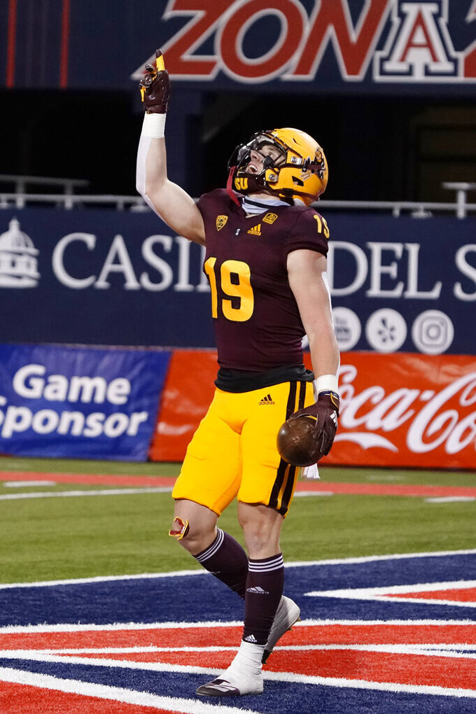 Arizona State wide receiver Ricky Pearsall celebrates after scoring a touchdown against Arizona in the first half of an NCAA college football game, Friday, Dec. 11, 2020, in Tucson, Ariz. (AP Photo/Rick Scuteri)