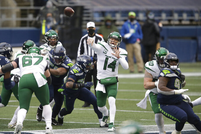 New York Jets quarterback Sam Darnold (14) throws against the Seattle Seahawks during the first half of an NFL football game, Sunday, Dec. 13, 2020, in Seattle. (AP Photo/Lindsey Wasson)