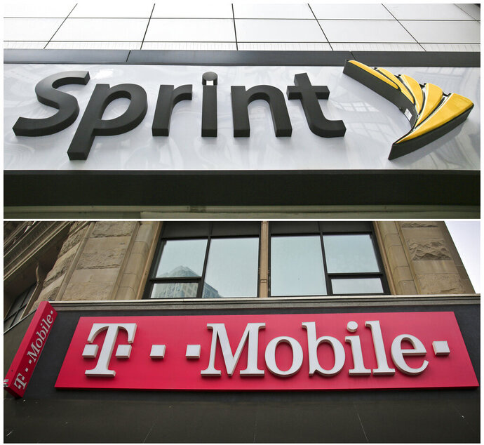 """FILE - This combination of April 30, 2018, file photos shows signage for a Sprint store in New York's Herald Square, top, and signage at a T-Mobile store in New York. T-Mobile CEO John Legere said if his company's $26.5 billion deal to buy Sprint fails, it may have to raise prices to slow user growth and relieve stress on the T-Mobile network. He said that would be his """"worst nightmare.""""  (AP Photo/Bebeto Matthews, File)"""