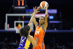 Los Angeles Sparks forward Nia Coffey (12) defends against Connecticut Sun forward DeWanna Bonner (24) during the first half of WNBA basketball game Thursday, Sept. 9, 2021, in Los Angeles. (AP Photo/Ashley Landis)
