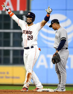Houston Astros' Robinson Chirinos, left, reacts after his game-tying two-run double as New York Yankees shortstop Gleyber Torres looks on during the seventh inning of a baseball game Monday, April 8, 2019, in Houston. (AP Photo/Eric Christian Smith)