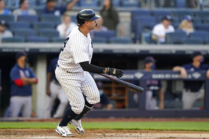 New York Yankees Gary Sanchez watches his first-inning two-run double in a baseball game against the Boston Red Sox, Sunday, June 6, 2021, at Yankee Stadium in New York. (AP Photo/Kathy Willens)