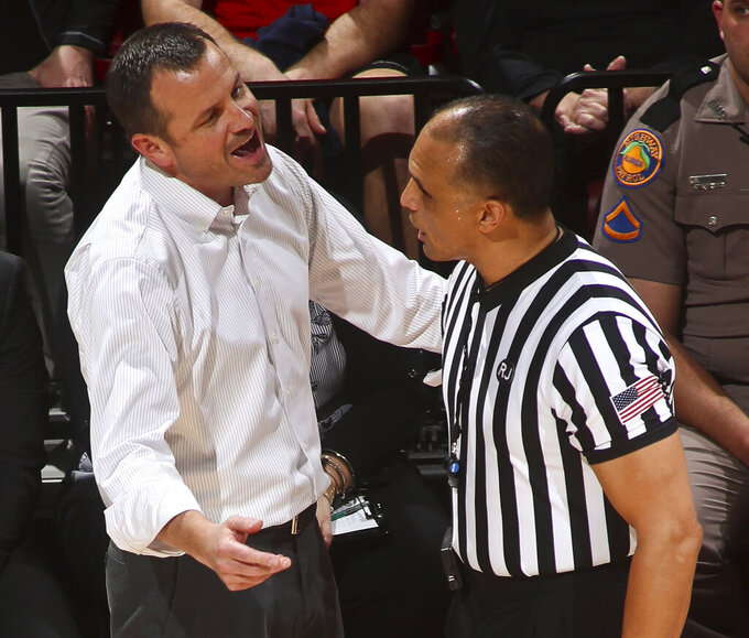 Louisville coach Jeff Walz argues with official Billy Smith during the first half of the team's NCAA college basketball game against Florida State in Tallahassee, Fla., Thursday, Jan. 24, 2019. (AP Photo/Phil Sears)