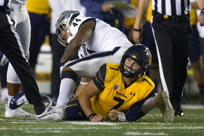 California quarterback Chase Garbers (7) looks up after he was sacked by Nevada defensive end Daniel Grzesiak (44) during the fourth quarter of an NCAA college football game, Saturday, Sept. 4, 2021, in Berkeley, Calif. (AP Photo/D. Ross Cameron)