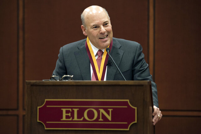 In this March 1, 2017 photo, Elon Trustee Louis DeJoy is honored with Elon's Medal for Entrepreneurial Leadership in Elon. N.C. DeJoy, a Republican fundraiser and prolific political donor from North Carolina, will be the next postmaster general. DeJoy of Greensboro, a close ally of President Donald Trump, was the unanimous pick of the U.S. Postal Service's Board of Governors, which made the announcement.  (Kim Walker/Elon University via AP)