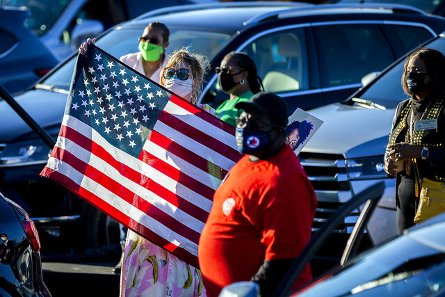 Supporters wait for Vice President-elect Kamala Harris attend a drive-in rally in Savannah, Ga. during a campaign stop for Democratic U.S. Senate challengers the Rev. Raphael Warnock and Jon Ossoff, Sunday, Jan. 3, 2021, in Savannah, Ga. (AP Photo/Stephen B. Morton)