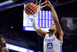 Kentucky's EJ Montgomery (23) dunks near Vanderbilt's Ejike Obinna during the first half of an NCAA college basketball game in Lexington, Ky., Wednesday, Jan 29, 2020. (AP Photo/James Crisp)