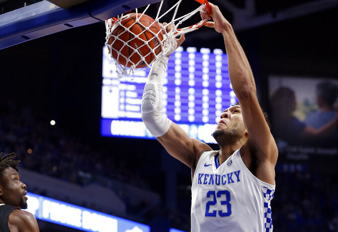 Kentucky's EJ Montgomery (23) dunks near Vanderbilt's Ejike Obinna during the first half of an NCAA college basketball game in Lexington, Ky., Wednesday, Jan 29, 2020. (AP Photo/James Crisp)