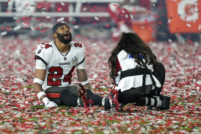 Tampa Bay Buccaneers cornerback Carlton Davis celebrates at the end of the NFL Super Bowl 55 football game against the Kansas City Chiefs Sunday, Feb. 7, 2021, in Tampa, Fla. The Buccaneers defeated the Chiefs 31-9 to win the Super Bowl. (AP Photo/Chris O'Meara)