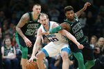 Boston Celtics' Daniel Theis (27) and Marcus Smart (36) defends against Charlotte Hornets' Cody Zeller (40) during the first half of an NBA basketball game in Boston, Sunday, Dec. 23, 2018. (AP Photo/Michael Dwyer)